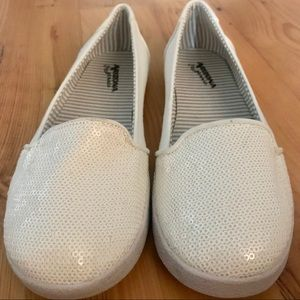 Arizona. White slip ons with sequin toes.